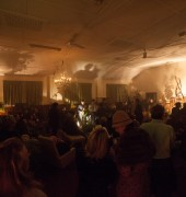 dark, smokey room with people listening to a jazz band