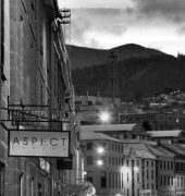 Black and white image looking down Salamanca Place showing Aspect Design and Mount Wellington in the background
