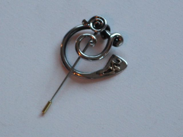 Penannular Brooch Forged stainless steel and cast bronze