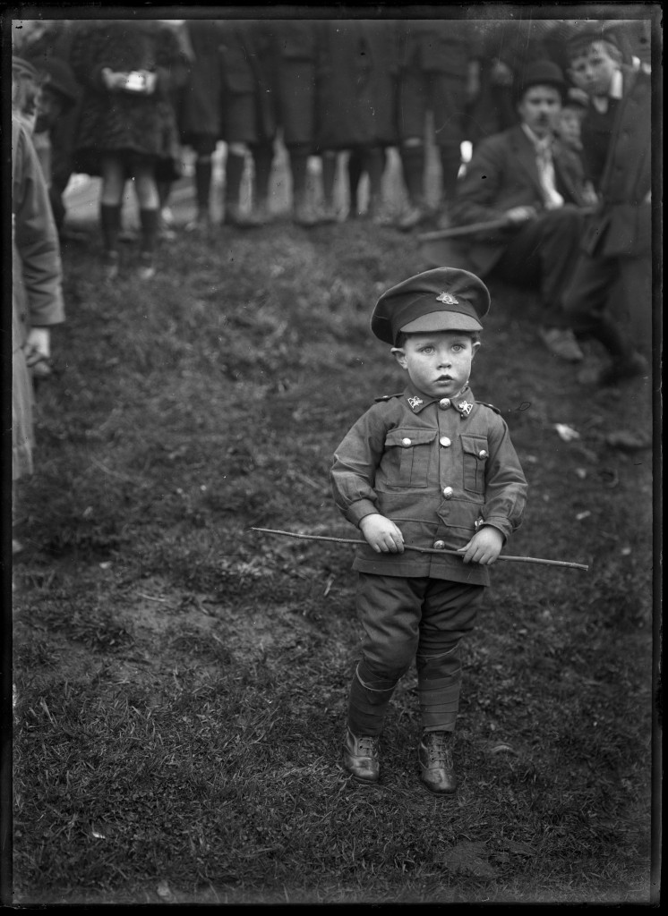 Small boy in soldier's uniform for World War I peace celebrations at Waratah, c.1919, glass plate negative,