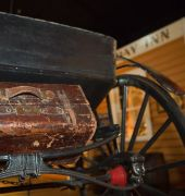 Image of a carriage and suitcase