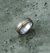 Image of Damascus steel ring with an 18ct yellow gold central inlay