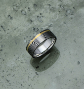 Image of Damascus steel ring with an 18ct yellow gold off-centre inlay