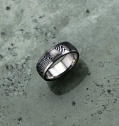Image of Damascus steel ring with titanium liner and rails