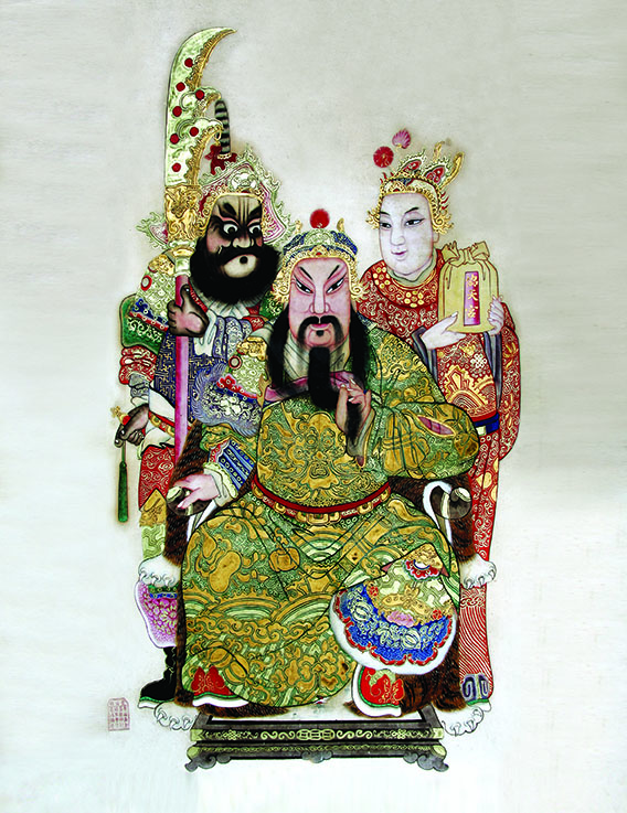 Painting hung in the main altar of the Guan Di Temple. Guan Di (centre) with his sworn brothers Zhang Fei (left) and Liu Bei (right).