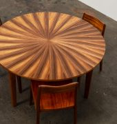 Blackwood sunburst dining table with Rose dining chairs