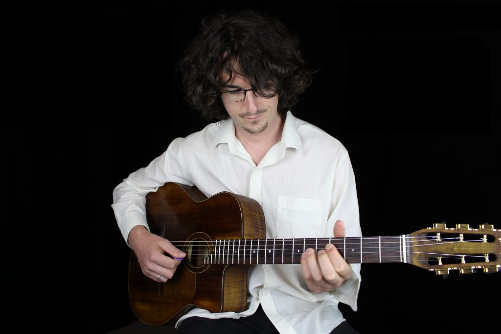 Harry Edwards playing solo guitar