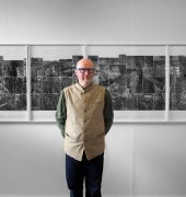 photograph of Raymond standing in front of Elsewhere World