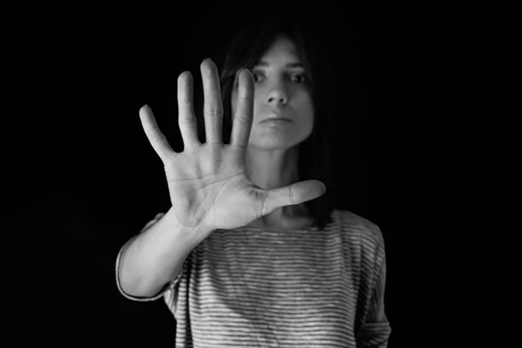 Stop; woman making stop gesture with her hand
